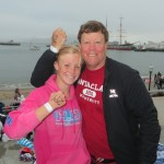 Kate and her dad pose before the swim (see Alcatraz waaaay in the background)?  :)