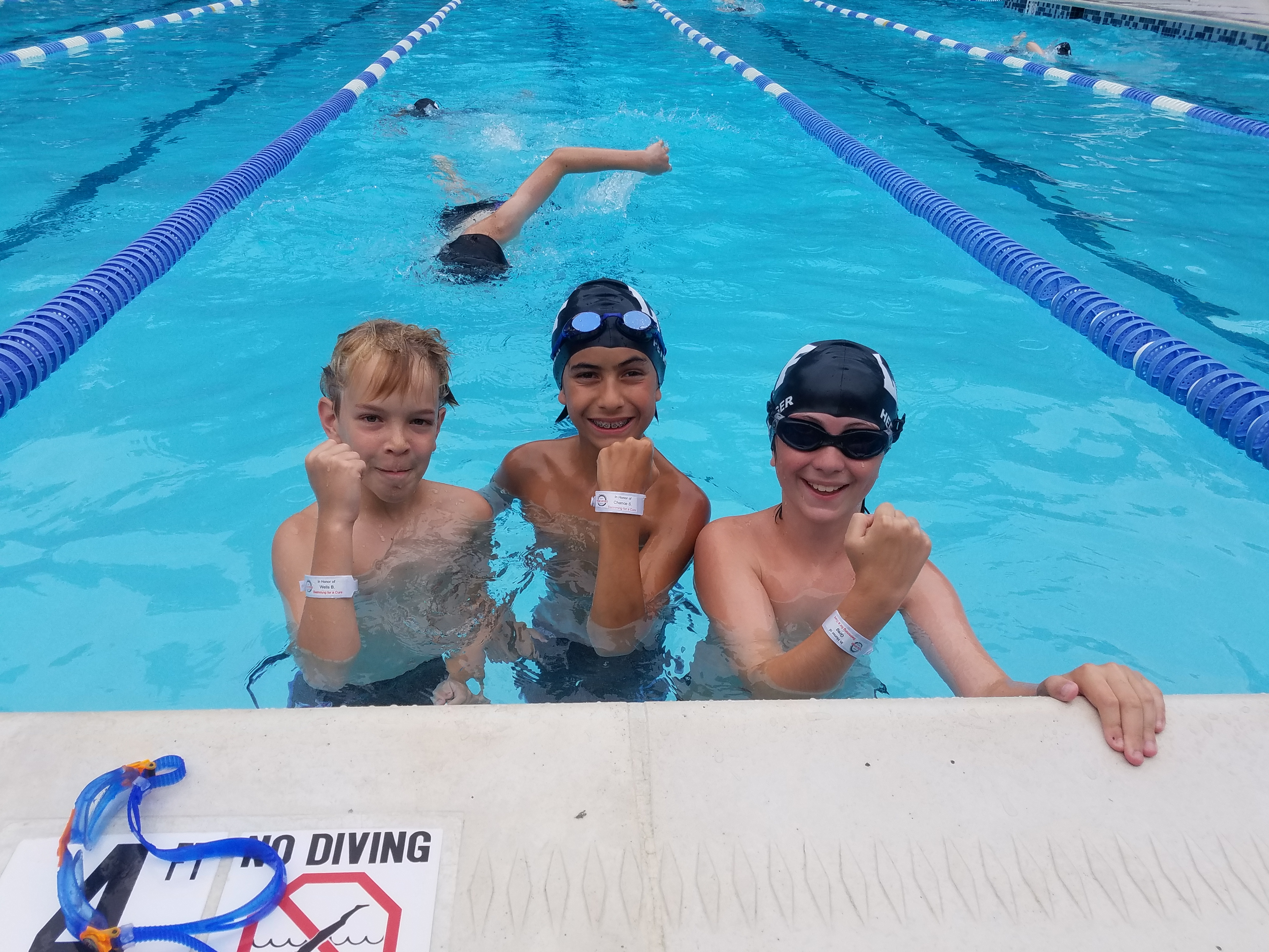 Each swimmer learned the personal story of someone living with hydrocephalus, and wore a bracelet bearing their name!